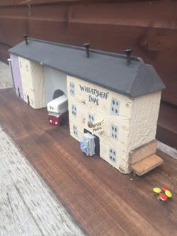 wooden bus, village inn, bench