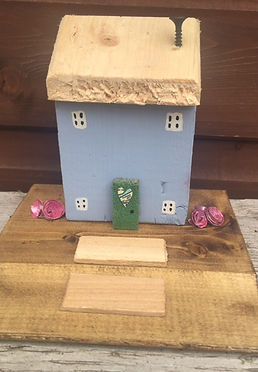 rustic cottage. wooden houses. upcycle shabby chic, sky blue, paper roses, wooden stops