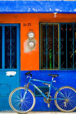 Blue & Orange Wall with Blue Bike