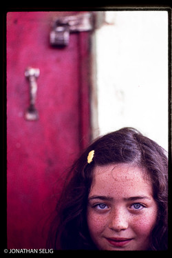 Girl with Freckles and Red Door