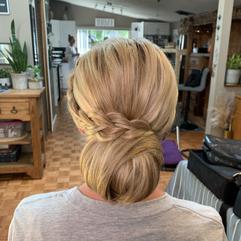 Low bun with a side braid