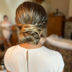 Low bun with a side braid for bridesmaid