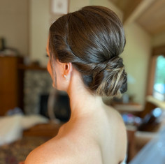 Low bun fro bridesmaid