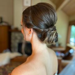 Low bun fro bridesmaid