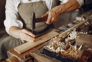 handsome-carpenter-working-with-wood.jpg