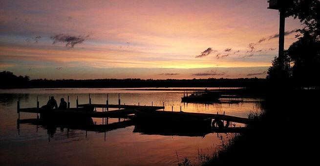 Beautiful sunset view down the shoreline of Sunset Bay Resort