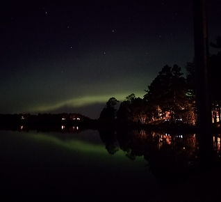 The Northern Lights over Baby Lake on a clear summer night