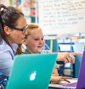 Teacher and student on laptop learning coding