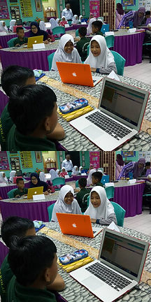 Students learning to code on laptops