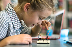 female student learning robotic circuits