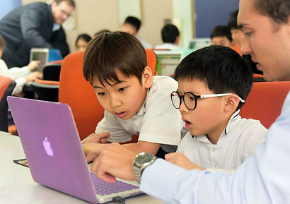 Teacher and students on laptop