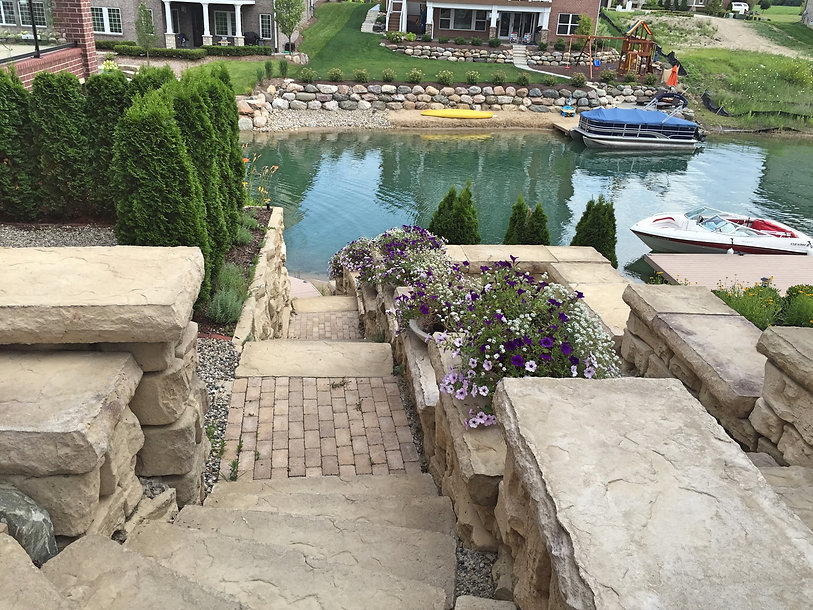 stone stairs - stone retaining wall - annual color - trees