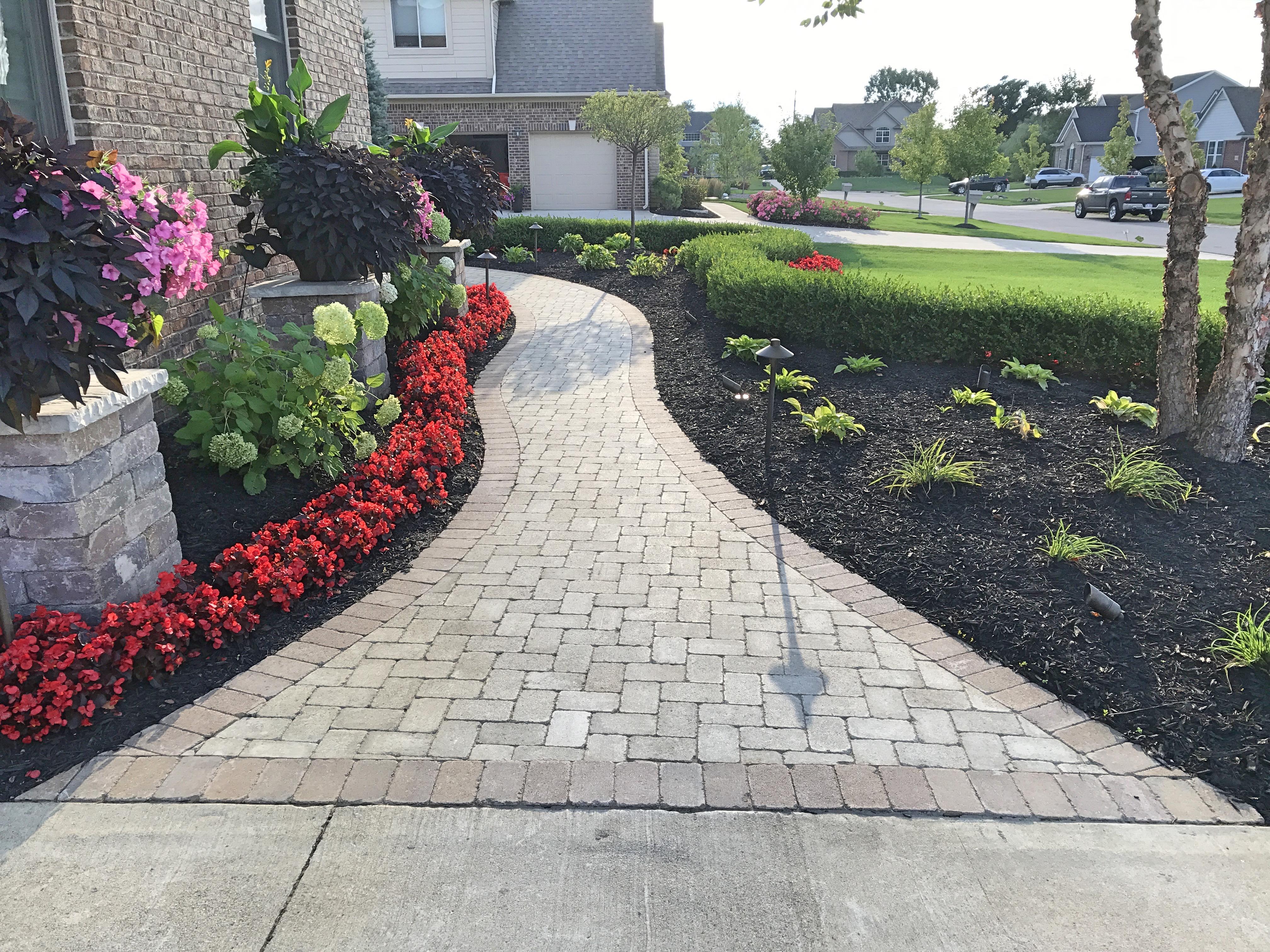 brick walkway - annual color - shrubs - mulch