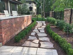 stone walkway - shrubs - mulch