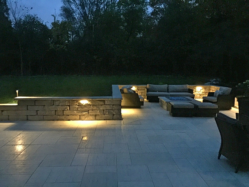 stone patio - low voltage lighting - stone and glass fire place