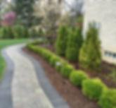 trees - shrubs - mulch - brick walkway