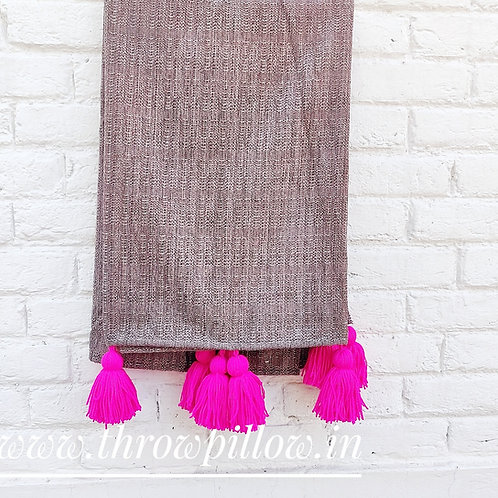 Textured Brown Couch Cover with Fuschia tassels