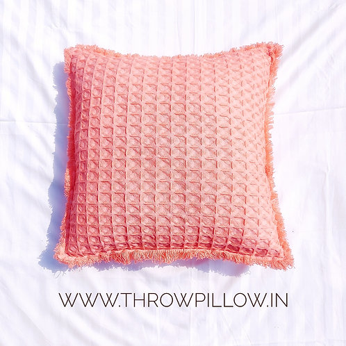Coral Waffle weave cushion with side fringes