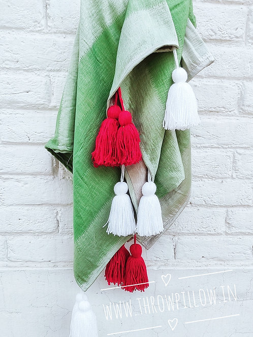 Green Throw with white & red tassels
