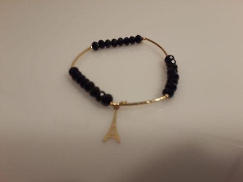 bracelet whit crystal  rocks and imitacion gold and torre eifel pending