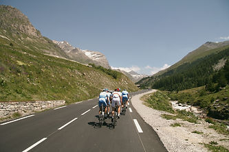 Group of cyclists on mountain road