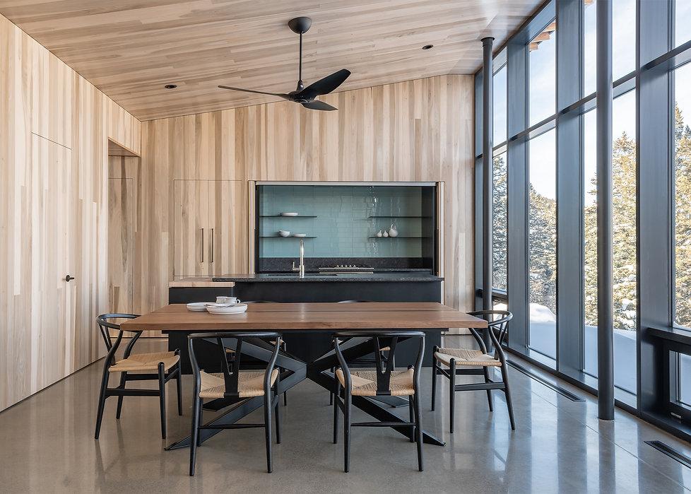 Minarik Architecture Bridger Canyon house, dining room wood clad ceiling walls tall windows tile kitchen celing fan