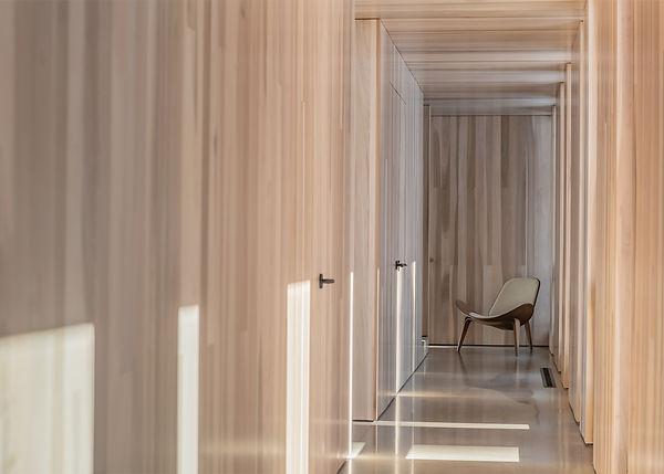 Minarik Architecture Bridger Canyon residence hallway wood clad ceiling wood clad walls chair