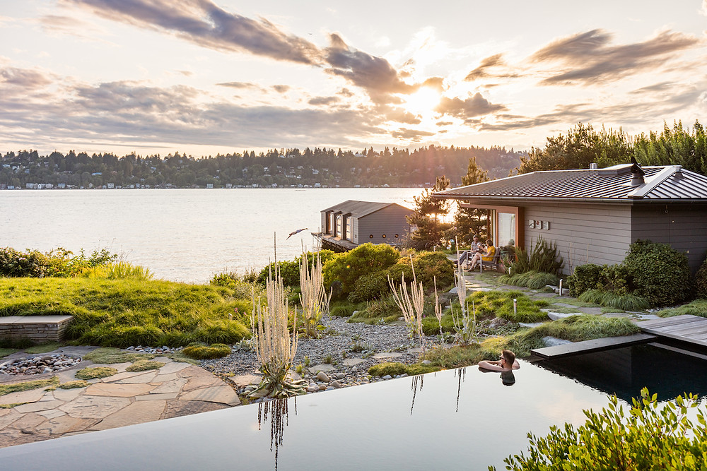 Lakefront home with infinity pool and boathouse