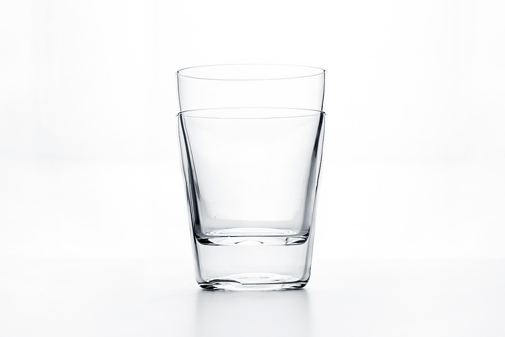 Clear drinking glasses stacked