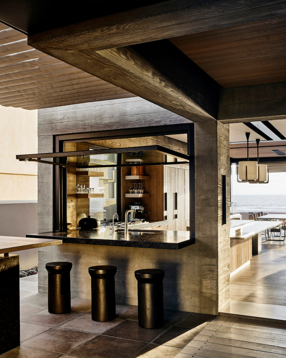 modern beach house indoor outdoor kitchen eating bar wood clad stools