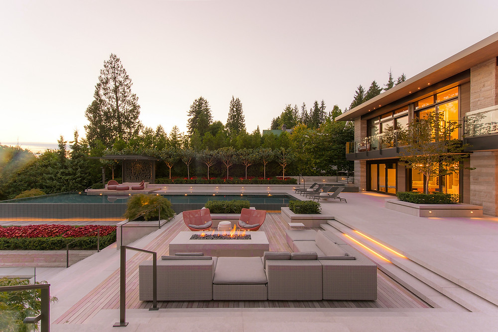 Modern landscape with patio and pool red outdoor seating, outdoor fireplace