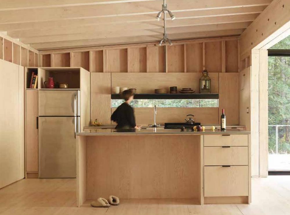 wood kitchen in prefab off the grid island cabin