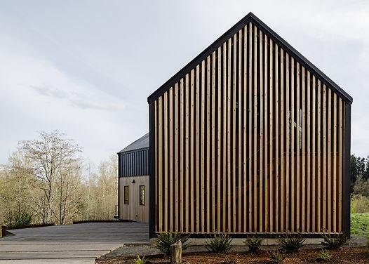 Minarik Architecture Springwater Trail exterior of house, graphic house shape, wood slats,, metel, trees, landscape