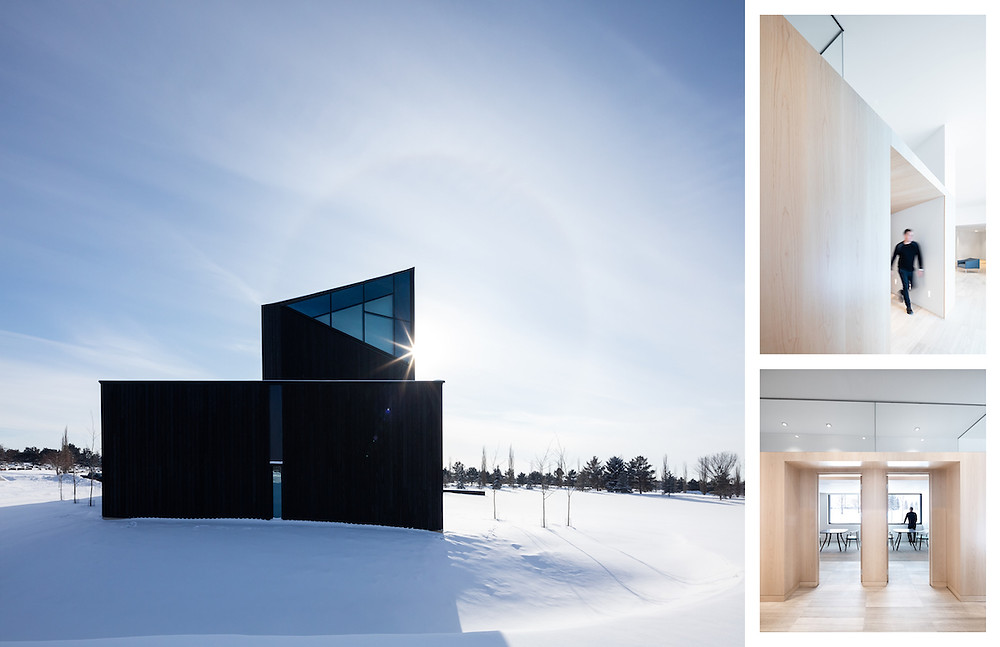 Exterior of black building on sunny winter day in snowy landscape, man dressed in black walking through interior of building with light wood walls
