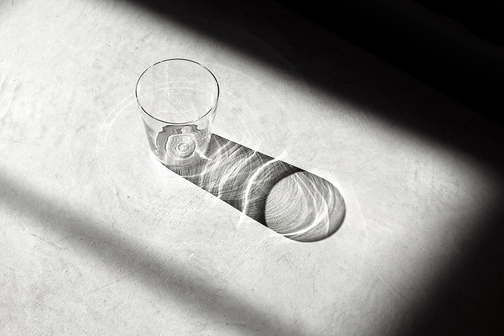 Clear drinking glass with shadow and pattern