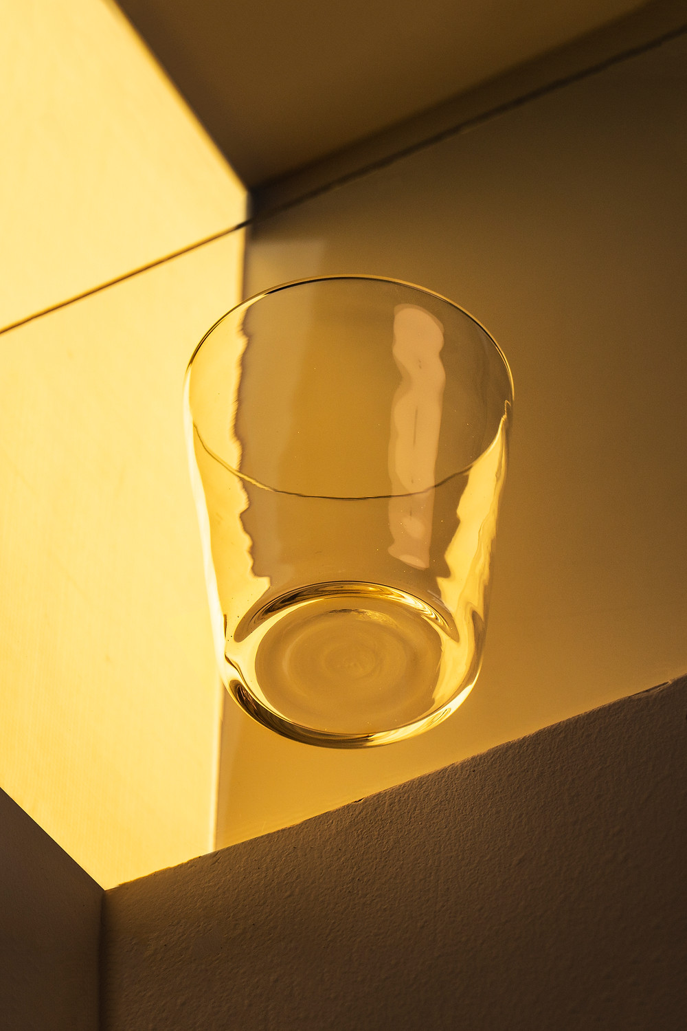 Clear drinking glass on amber background