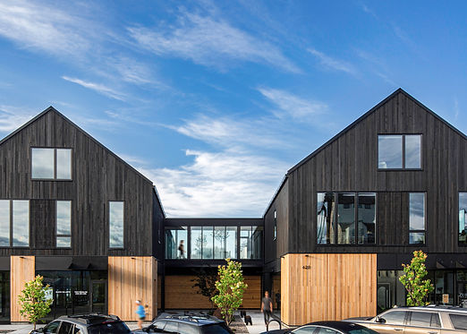 Minarik Architecture mixed use building dark and light wood wood slats skywalk trees people
