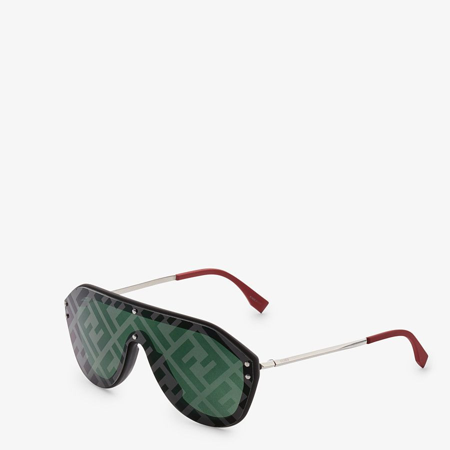Fendi Fabulous shield sunglasses. Made of black rubber-texture injection-molded frame, silver-colored metal temples and red rubberized temple tips. The green single lens is decorated with a tone-on-tone effect FF logo mirror print