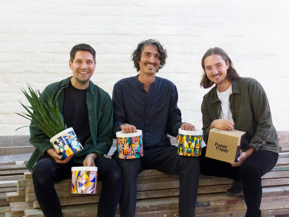 Swedish brand Poppy Poppy co-founders with colorful flowerpots: Daniel Engström, CMO (left), Adam Hjort, CEO (center), and Adam Strandberg, Chief of Design (right).