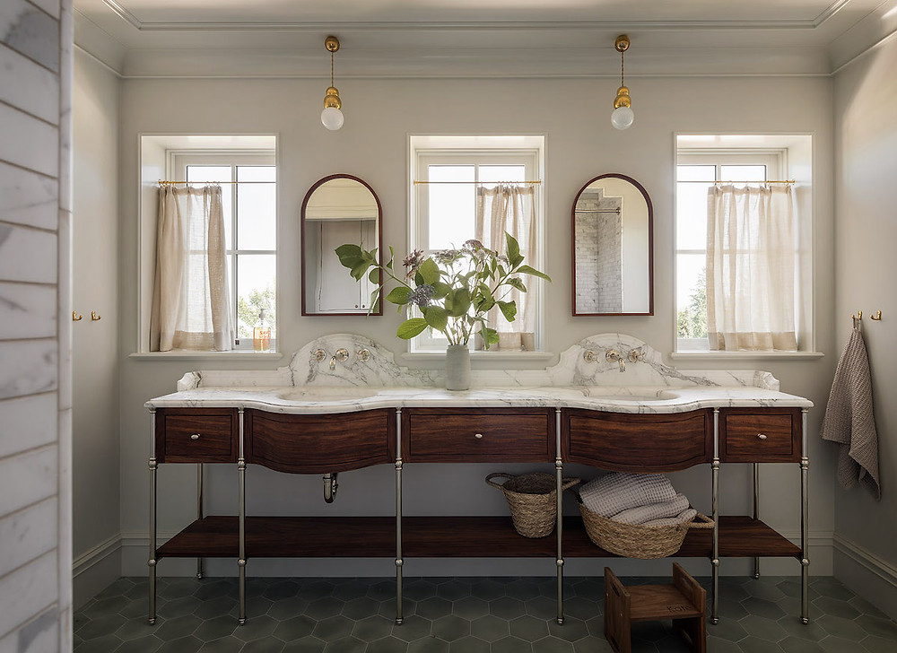 luxury bathroom with globe pendant lights, double vanity marble and dark wood double mirrors cure top mirrors