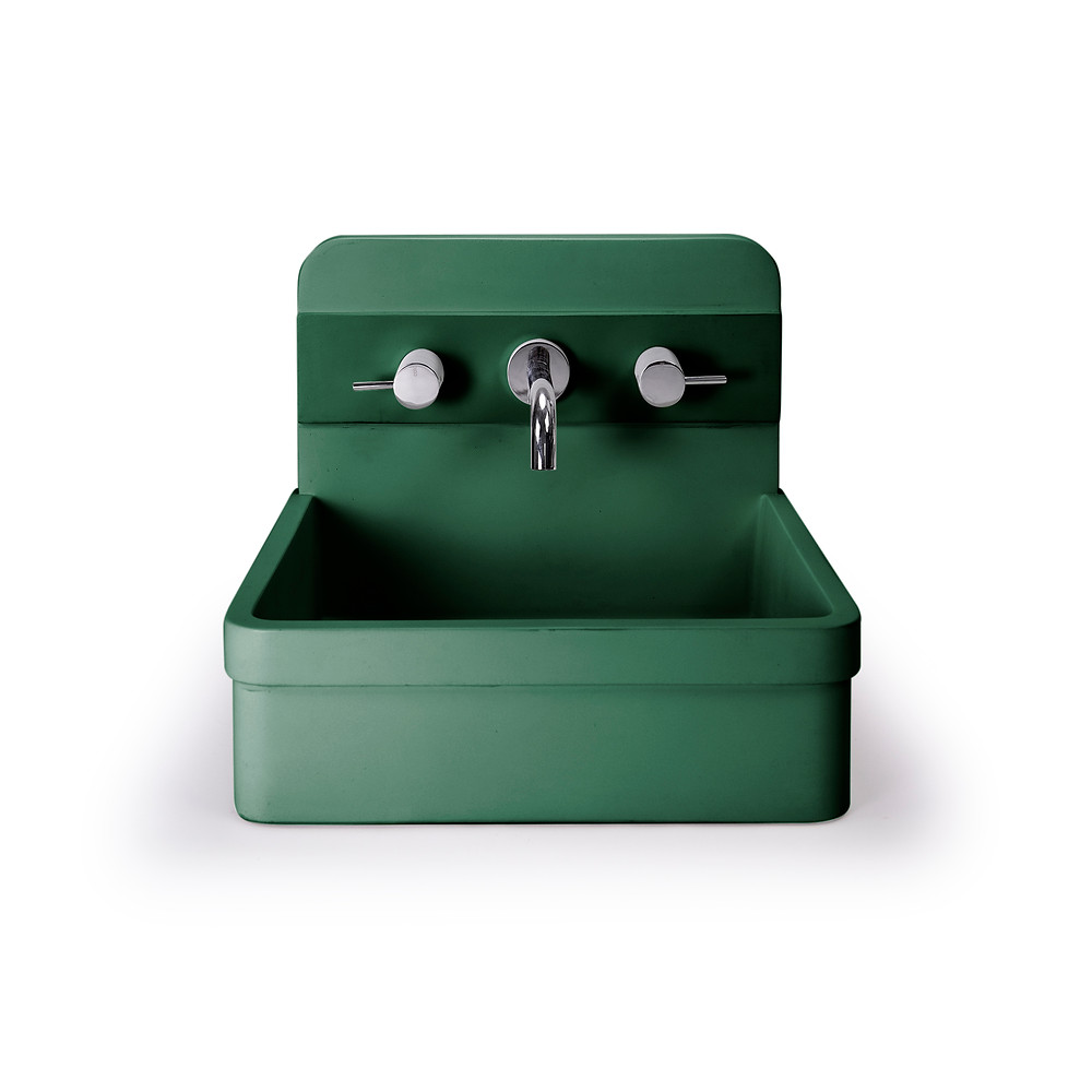 emerald green sink basin with tall back, curved corners. silver faucet fixtures, concrete sink