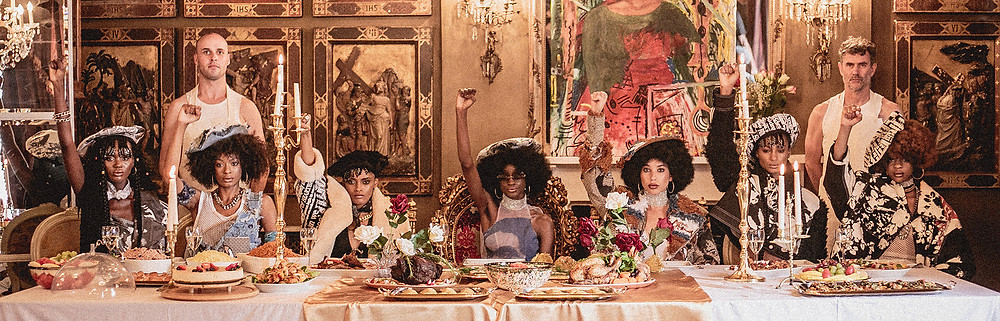 Tolu Coker fashion shoot at last supper style table with Black Panther women and black power fist