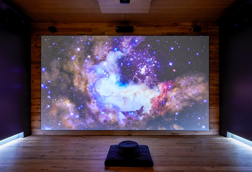 Yoga room, space age, video screen, wood floor wood ceiling wood walls