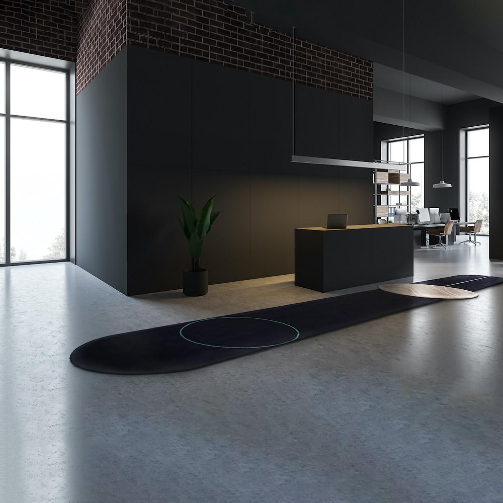 Office with reception desk, runner carpet, black walls, red brick, modern industrial office