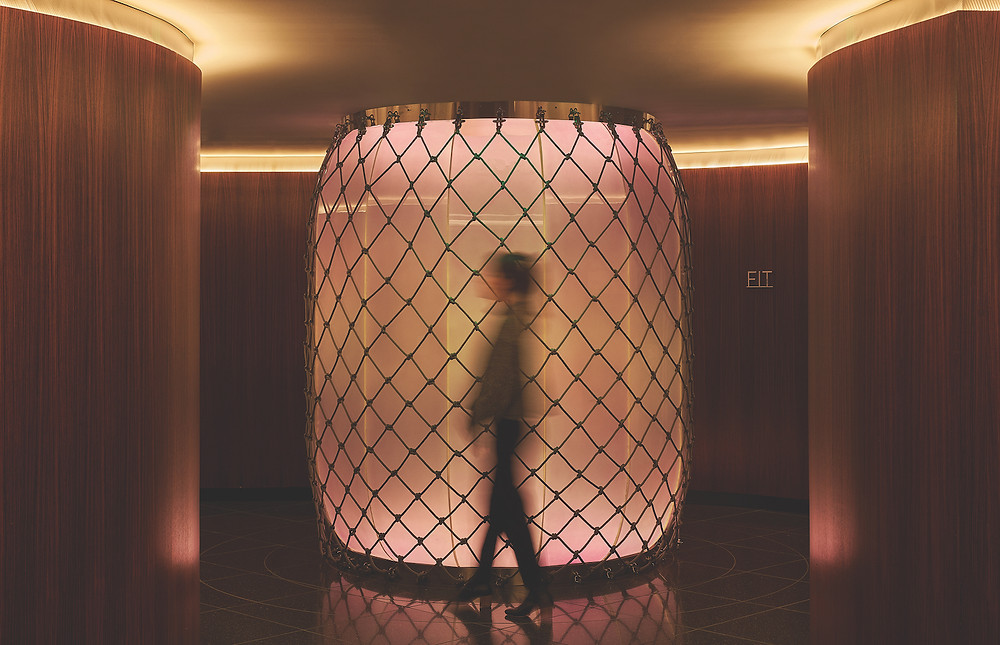 Modern hotel elevator with woman walking by