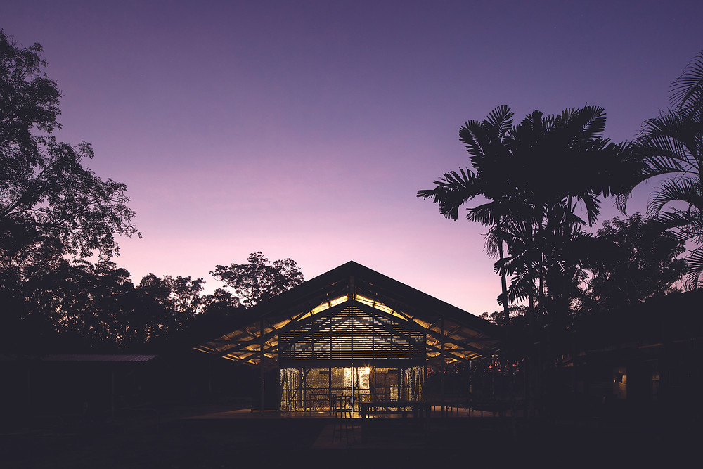 Purple sky, dusk shot, exterior building. Commissioned by the Munupi Arts and Crafts Association, the Art Centre at Pirlangimpi (Garden Point) is located on Melville Island in the Tiwi Islands north of Darwin, Australia.