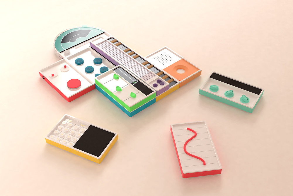 Chora, a music learning instrument with stackable magnetic module blocks of different instruments and sound effects in primary colors on a peach background.