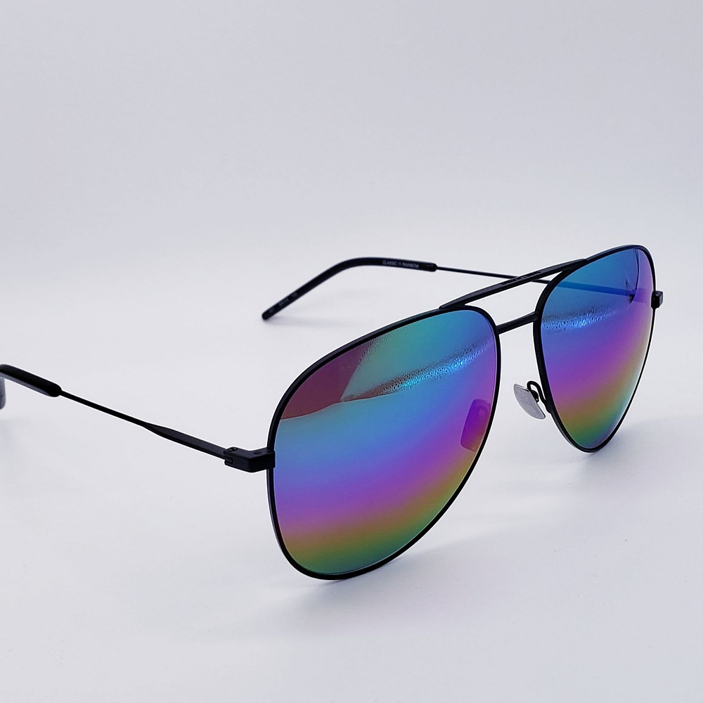 Saint Laurent Classic aviator sunglasses with rainbow mirror lense and black frames on gray background