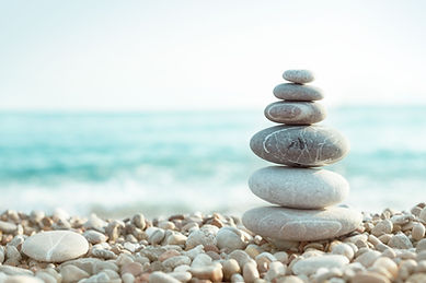 white rocks stacked on beach.jpg