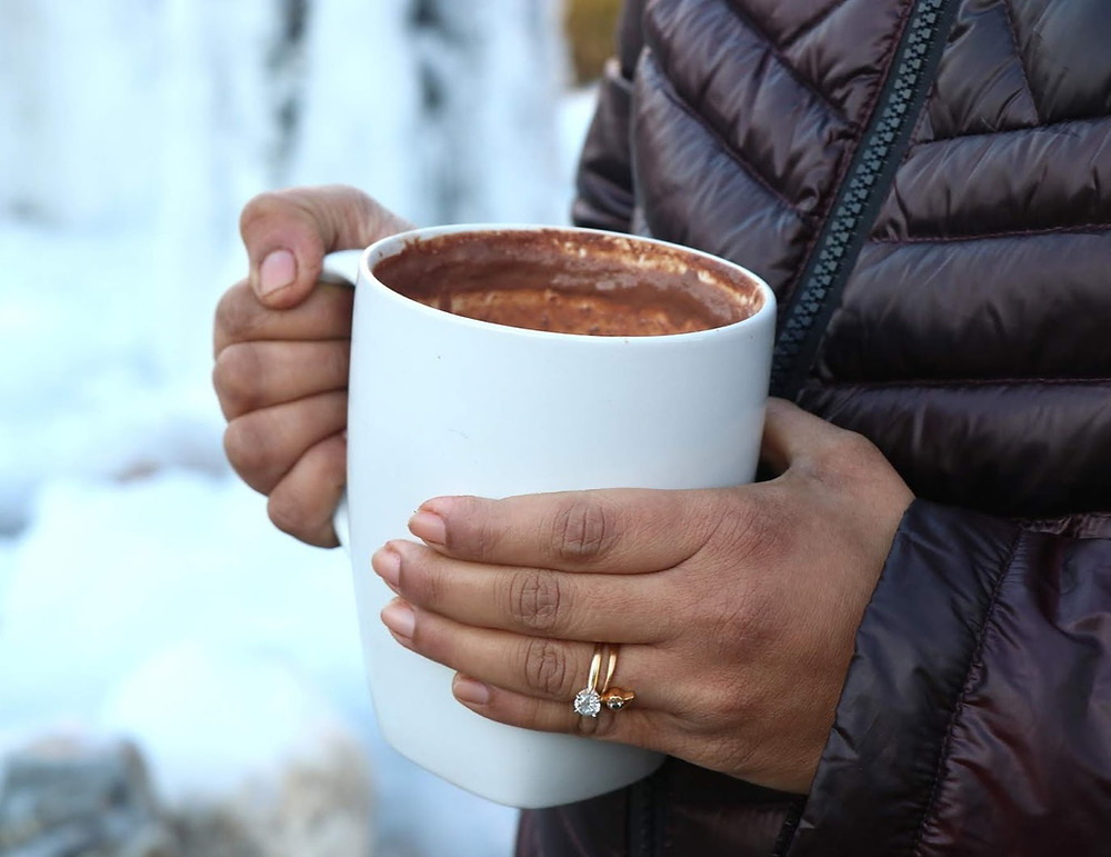 Person holding a cup of hot chocolate